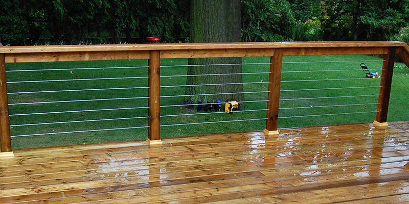 Wooden railing with cable